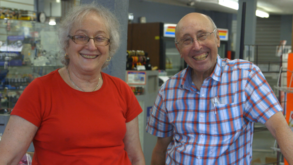 A photo of Karen and Barry Mason, subjects of Circus of Books, smiling directly into the camera.