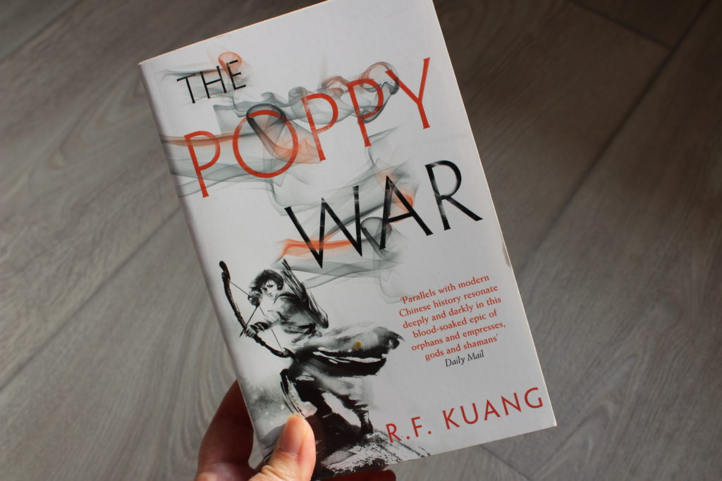 A close up photo of the cover of The Poppy War by RF Kuang.
